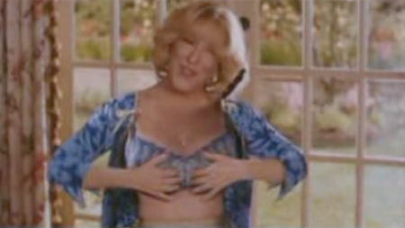 Bette Midler has large breasts, so what did she decide to do?
